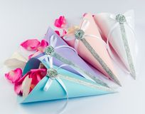 Rose petals in confetti cones with satin ribbon Royalty Free Stock Images