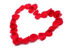 Rose petals forming heart shape Royalty Free Stock Photography