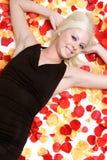 Rose Petals Girl. Pretty blond rose petals girl royalty free stock images