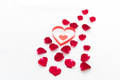 Rose petals and heart paper isolated on white Royalty Free Stock Image