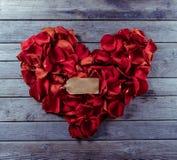 Rose petals in heart shape Stock Photo