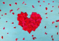 Rose petals in heart shape Stock Photography
