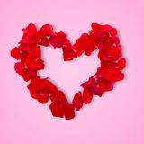 Rose petals in heart shape. Valentine greeting Royalty Free Stock Image