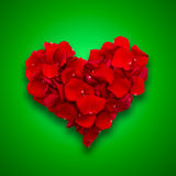 Rose petals in heart shape. Valentine greeting stock photo