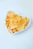 Rose petals in heart shaped bowl Stock Image