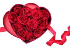 Rose petals in heart-shaped box stock photos