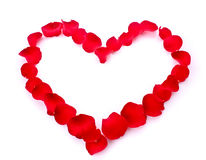 Rose petals in heart symbol isolated Royalty Free Stock Photos