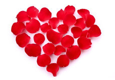 Rose petals in heart symbol isolated Stock Photography