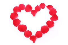 Rose petals in heart symbol isolated Stock Photos
