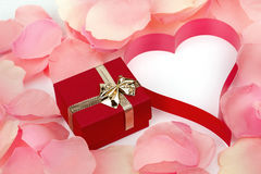 Rose petals, heart and valentine present box background Royalty Free Stock Images