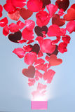 Rose petals and hearts flying out of a gift box Royalty Free Stock Photos