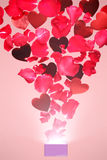 Rose petals and hearts flying out of a gift box Royalty Free Stock Photography