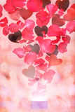 Rose petals and hearts flying out of a gift box Royalty Free Stock Images