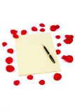 Rose petals and letter paper royalty free stock image