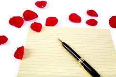 Rose petals and  letter paper Stock Photos