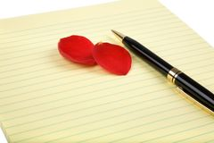 Rose petals and  letter paper Royalty Free Stock Photo