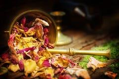 Rose petals in mortar, natural cosmetics. Rose petals in a mortar, natural cosmetics royalty free stock image