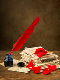 Rose petals and old letters Royalty Free Stock Photography