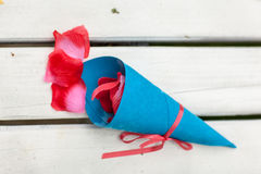 Rose petals with paper cone. Stock Images