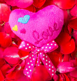 Rose Petals and pink heartson a wooden Royalty Free Stock Images