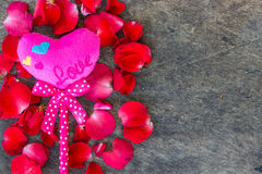 Rose Petals and pink heartson a wooden Stock Image