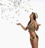 Rose petals rain down on a beautiful woman Royalty Free Stock Image