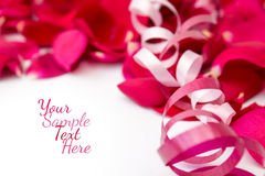 Rose petals with ribbons Royalty Free Stock Images