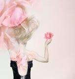 In rose petals Stock Image