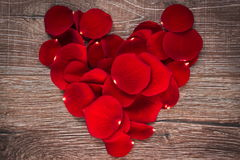 Rose petals in shape of heart Royalty Free Stock Photography