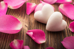 Rose petals. Rose petals and stone hearts stock photo