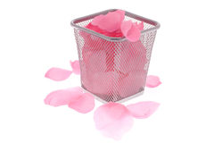 Rose Petals in the wastepaper basket Royalty Free Stock Photography