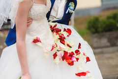 Rose petals on a wedding dress Royalty Free Stock Photo