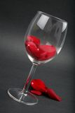 Rose petals in a wine glass Royalty Free Stock Images