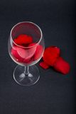 Rose petals in a wine glass Stock Images