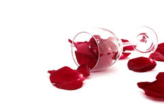 Rose petals, wine glass isolated on a white background. Love concept, selective focus stock photography