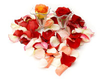 Rose petals and wine glasses Royalty Free Stock Photo