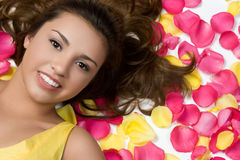 Rose Petals Woman. Pretty woman in rose petals royalty free stock photography