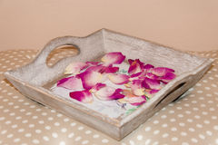 Rose Petals. On the wooden background Stock Photography