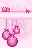 Rose pink christmas balls and bows. Decorated with snowflakes. Stars and snow in the background. Copy space for text Stock Images
