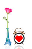 Rose in pot and clock heart. White background Royalty Free Stock Photo