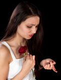 Rose pricking a finger Royalty Free Stock Photography