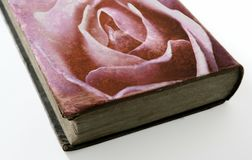 Rose printed on the cover of an old book Stock Photos