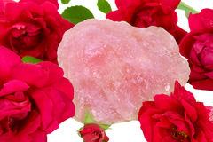 Rose Quartz. And red roses Royalty Free Stock Photo