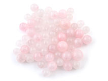 Rose quartz, beads pink stone in front of white background Royalty Free Stock Images