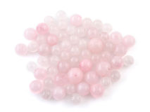 Rose quartz, beads pink stone in front of white background Stock Photo