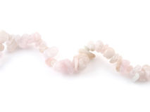 Rose quartz, beads pink stone in front of white background Stock Image