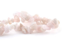 Rose quartz, beads pink stone in front of white background Royalty Free Stock Image