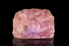Rose quartz in front of black Royalty Free Stock Photography