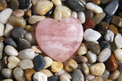 Rose Quartz Heart. Tumbled and polished rose quartz heart ♥ crystal for use in natural healing practice and alternative energy medicine Royalty Free Stock Images