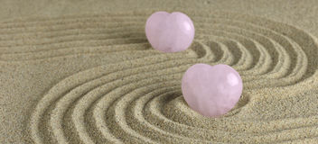 Rose Quartz heart in zen garden Royalty Free Stock Photos